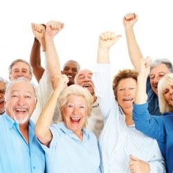 Group of happy senior citizens Portuguese with their hands raised over white